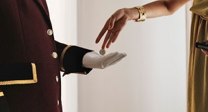 woman tipping hotel worker