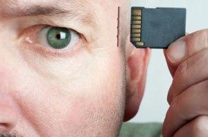 man-inserting-memory-card-in-brain