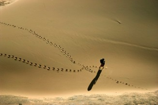 Nomad Woman Crossing Footprints