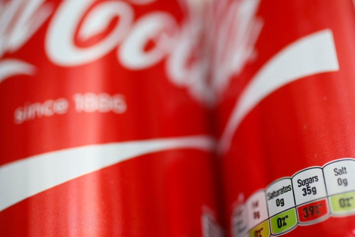 A detail of a can of Coca-Cola is seen in London, Britain March 16, 2016. Britain will introduce a sugar levy on soft drinks in two years' time to tackle a growing obesity crisis, finance minister George Osborne said in a surprise announcement on Wednesday, hitting share prices in drinks and sugar firms.  REUTERS/Stefan Wermuth - RTSAPUK