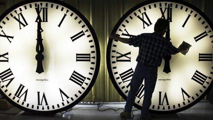 man-cleaning-clocks1